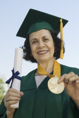http://www.dreamstime.com/royalty-free-stock-image-senior-female-graduate-holding-certificate-medal-image29645136