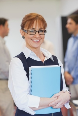 http://www.dreamstime.com/royalty-free-stock-photo-content-female-mature-student-posing-classroom-holding-some-files-smiling-camera-image35781835