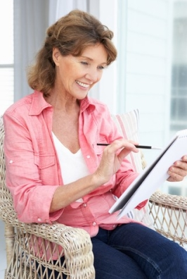 http://www.dreamstime.com/stock-images-happy-senior-woman-sketching-image21048114