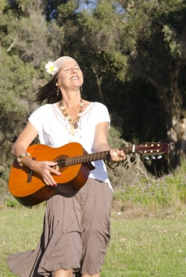 http://www.dreamstime.com/royalty-free-stock-photography-joyful-mature-hippie-woman-guitar-image27082457