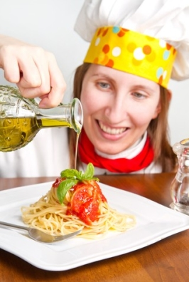 http://www.dreamstime.com/royalty-free-stock-images-smiling-chef-garnish-italian-pasta-dish-image30547879