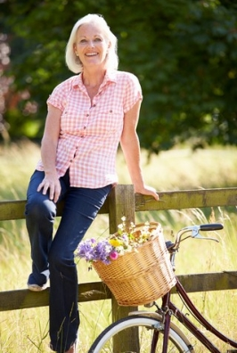 http://www.dreamstime.com/stock-images-middle-aged-woman-relaxing-country-cycle-ride-sitting-fence-smiling-to-camera-image35778584